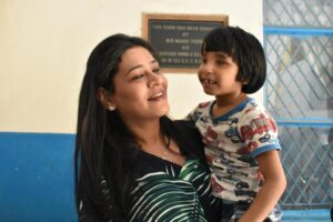Dr. Geetanjali Chopra, Founder, Wishes and Blessings with a visually impaired kid