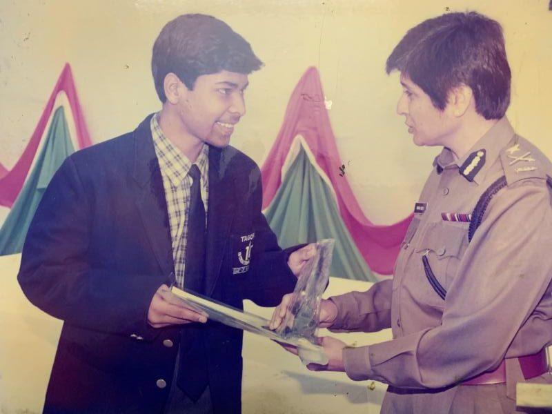 Nikhil Mittal receiving award