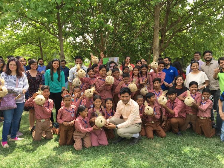 Vikrant Tongad with Kids distributing plants